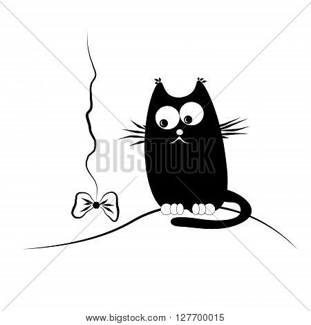 Cat with bow Black lazy fat funny cat watching toy in the shape of a bow