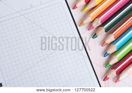 Colorful Pencils And Blank Notepad