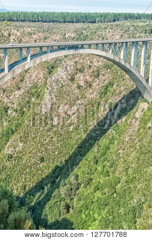 BLOUKRANS BRIDGE SOUTH AFRICA - MARCH 2 2016: A bungee jumper at the bottom end of the cord in the worlds highest commercial bungee jump at 216 meter above the River the highest bridge in Africa