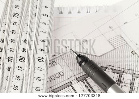 architecture drawings, pen, folding ruler & notepad