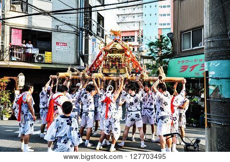 Osaka Japan - July 25 2012: Golden portable shrine carried and worshipped by participants of the Tenjin Matsuri Festival the greatest festival in Osaka boasting of a history of a thousand years.