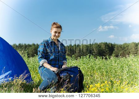 Hiker woman in summer forest