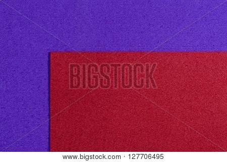 Eva foam ethylene vinyl acetate red surface on purple sponge plush background