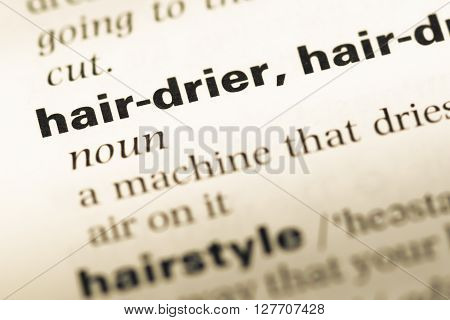 Close Up Of Old English Dictionary Page With Word Hair Drier.