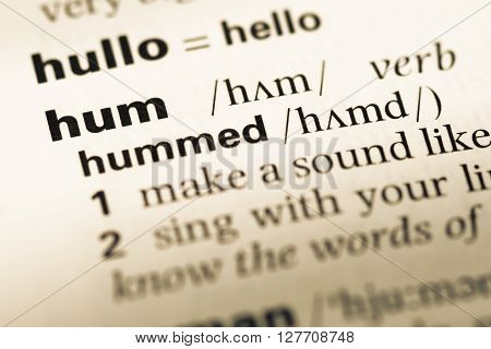 Close Up Of Old English Dictionary Page With Word Hum.
