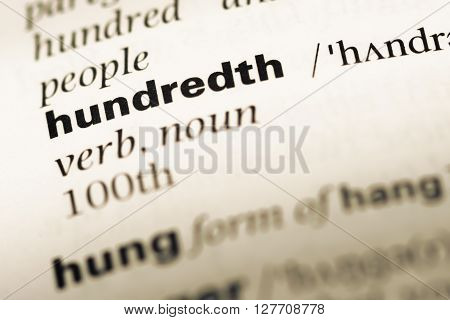Close Up Of Old English Dictionary Page With Word Hundredth.