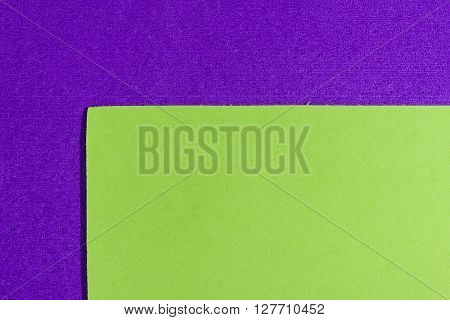 Eva foam ethylene vinyl acetate smooth apple green surface on purple sponge plush background