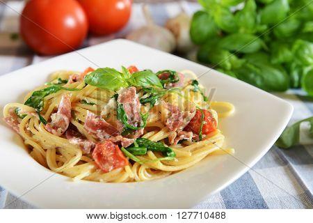 Spaghetti Pasta With Rucola, Cherry Tomatoes And Prosciutto Ham
