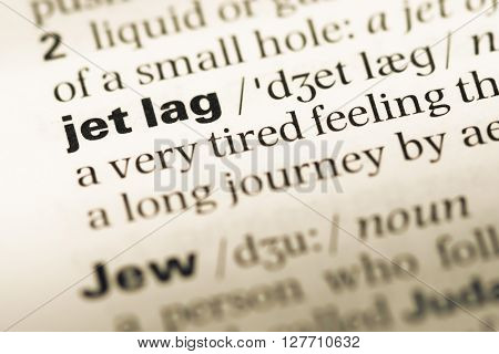 Close Up Of Old English Dictionary Page With Word Jet Lag.