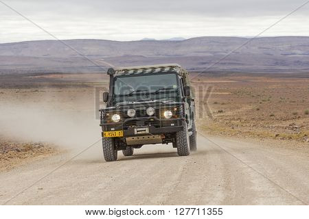 FISH RIVER CANYON NAMIBIA - SEPTEMBER 01 2015: SUV in the C12 scenic dirt road in the desert leading to the Fish River Canyon Namibia