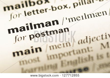 Close Up Of Old English Dictionary Page With Word Mailman.