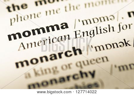 Close Up Of Old English Dictionary Page With Word Momma.