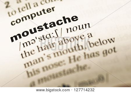 Close Up Of Old English Dictionary Page With Word Moustache.