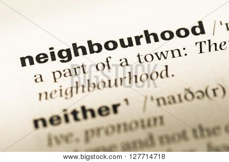 Close Up Of Old English Dictionary Page With Word Neighbourhood.
