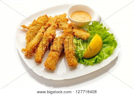 Fried battered fish fillet on white background.