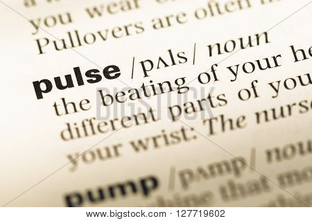 Close Up Of Old English Dictionary Page With Word Pulse.