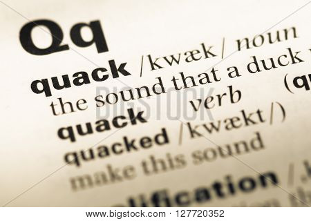 Close Up Of Old English Dictionary Page With Word Quack.