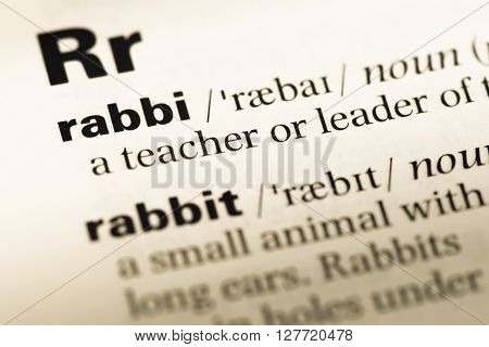 Close Up Of Old English Dictionary Page With Word Rabbi.