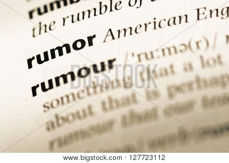 Close Up Of Old English Dictionary Page With Word Rumor.