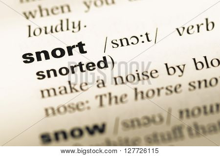 Close Up Of Old English Dictionary Page With Word Snort.