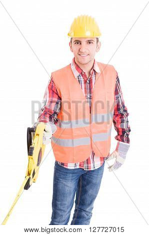 Professional builder unrolling an industrial meter reel on white background