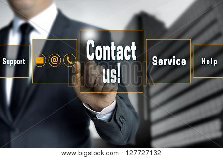 Contact Us Touchscreen Is Operated By Businessman
