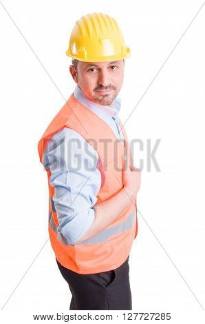 Buildings contractor posing on white background with yellow helmet and orange vest