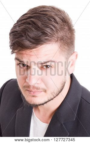 Portret of a young male model on white studio background