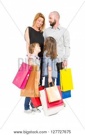 Shopping family of husband wife and two young daughters