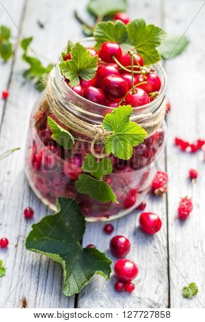 Glass Jar Full Of Fruits Cherries And Currants