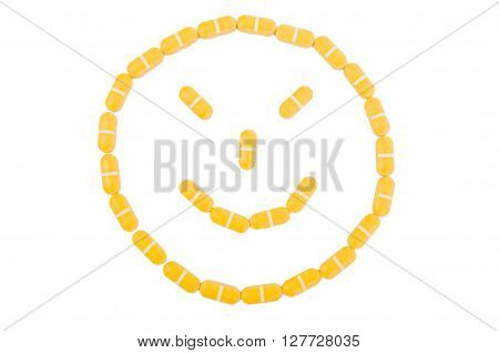 Evil face made of pills isolated on white background