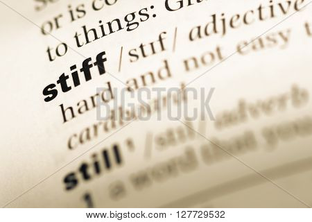 Close Up Of Old English Dictionary Page With Word Stiff.