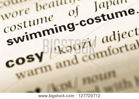 Close Up Of Old English Dictionary Page With Word Swimming Costume.