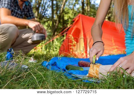 Hiking Picnic Young Couple cooking Meal in Camping