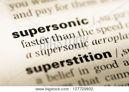 Close Up Of Old English Dictionary Page With Word Supersonic.
