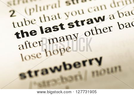 Close Up Of Old English Dictionary Page With Word The Last Straw.