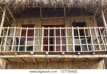 Close up of a bungalow made from bamboo and wood