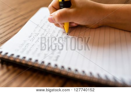 Person Writing By Hand On Notepad