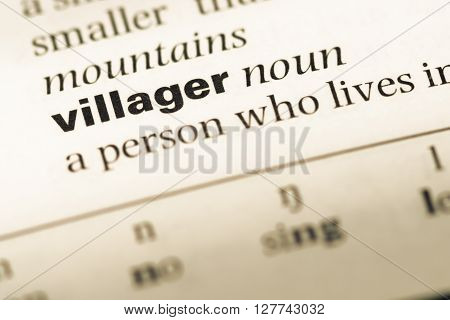 Close Up Of Old English Dictionary Page With Word Villager.