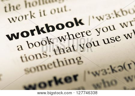 Close Up Of Old English Dictionary Page With Word Workbook.