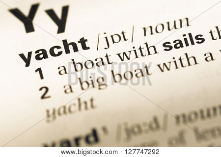 Close Up Of Old English Dictionary Page With Word Yacht.
