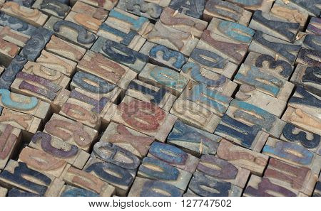 Vintage wooden letterpress blocks background with retro typescript