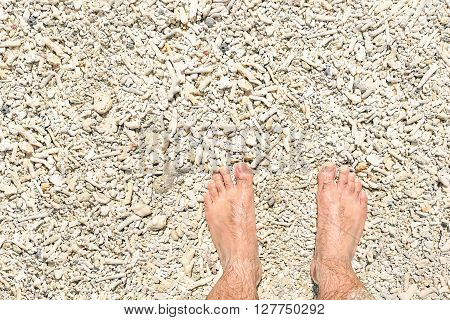 Naked human barefoot on coral beach background during island hopping in El Nido Palawan - Exclusive travel destination - Freedom and carefree lifestyle during tour around the world - Bright color tone