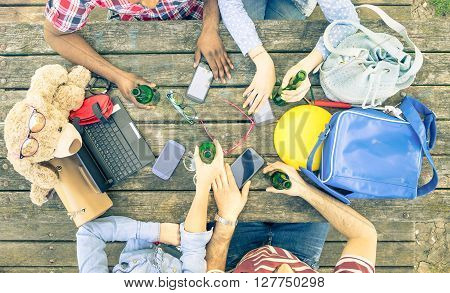 Group of friends drinking beer at hipster bar restaurants - People hands using smartphones with upper point of view - Technology concept with addicted men and women - Vintage desaturated filtered look