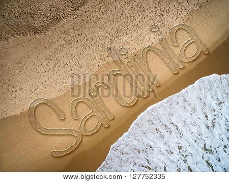 Sardinia written on the beach