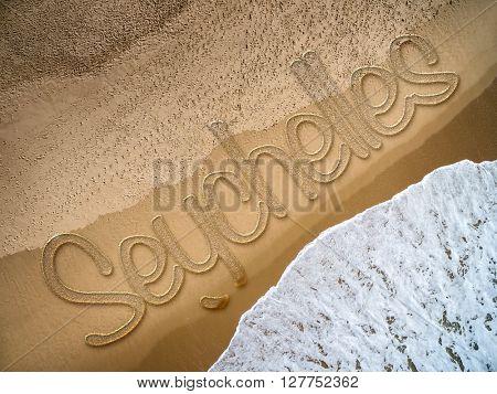 Seychelles written on the beach