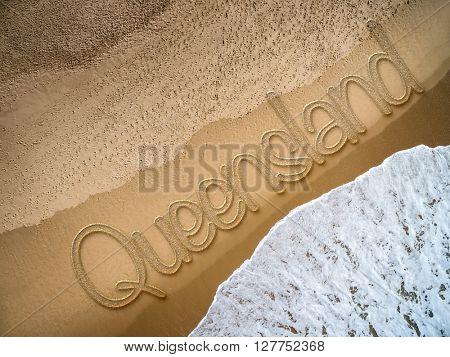 Queensland written on the beach