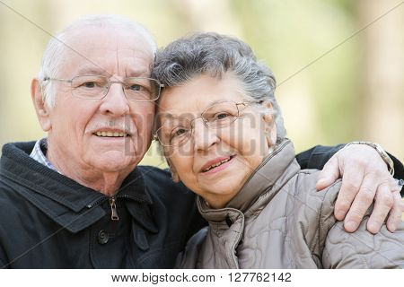 Closeup of elderly couple cuddling