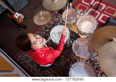 Portrait Of Drummer Performing In Recording Studio