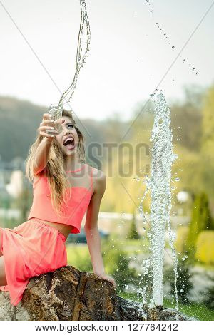 Happy Woman Near Fountain